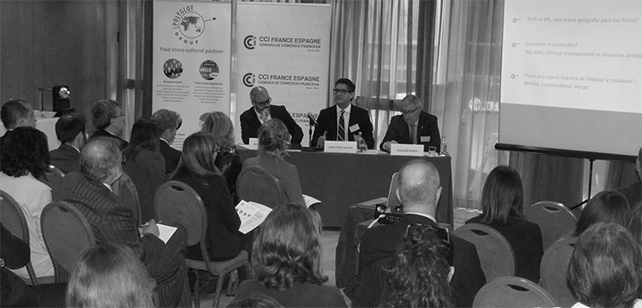 Panel speaking in front of audience